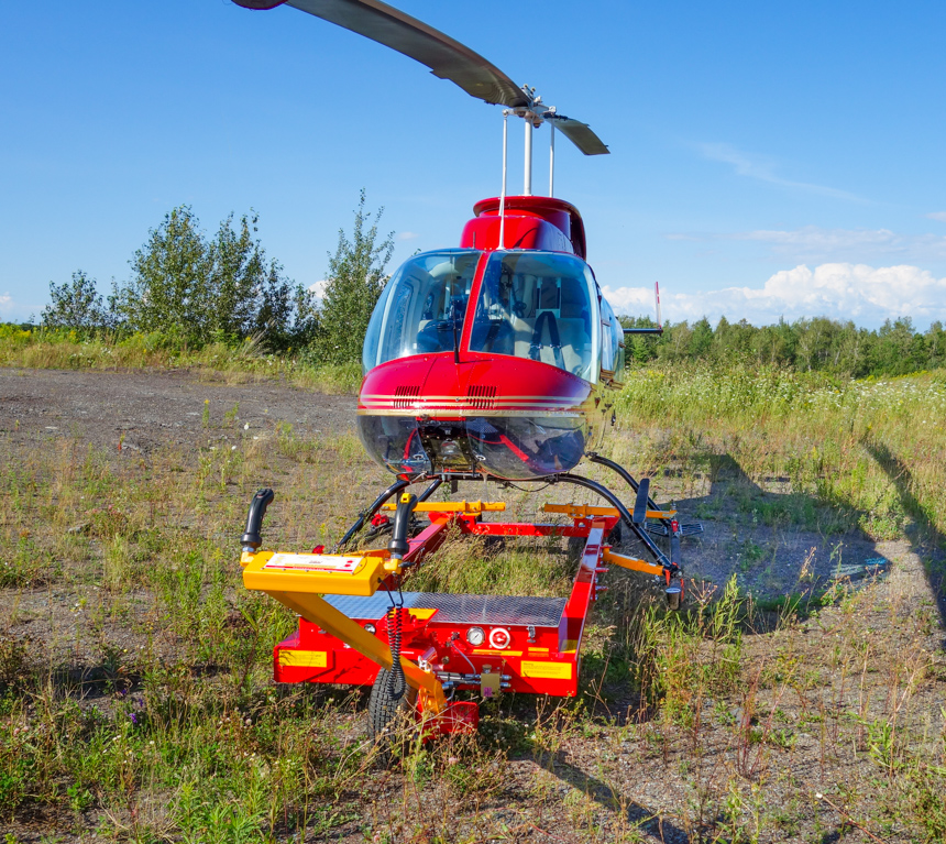 V1030 model with Bell 206 in rough terrain